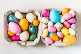 Easter colorful sweet candy eggs background top view. - 195916983