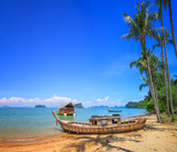 Old boat at beach with palm trees in Koh Yao Noi, Thailand - 195919542