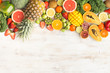 Fruits and vegetables rich in vitamin C, oranges mango grapefruit kiwi kale pepper pineapple lemon sprouts papaya broccoli, on wooden white table, top view, copy space, selective focus - 195923566