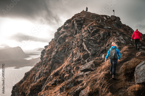 Foto op Canvas Zwart Hiking up a mountain in Haukland