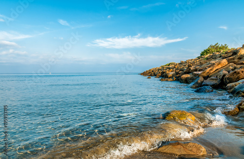 Plexiglas Pool Landscape of calm sea with blue water and rocks, Tuscany, Italy