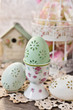 easter egg in porcelain egg cup with rose pattern