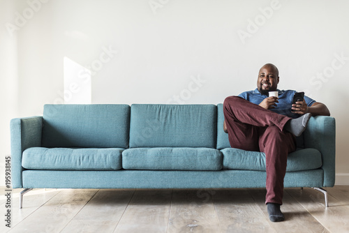 Black man using mobile phone