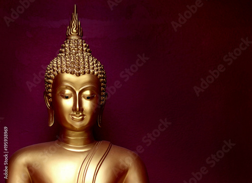 Foto op Aluminium Boeddha gold bhuddha statue close up smile face on vintage dark red background low key style