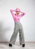 Woman in wide pants posing in studio - 195952738
