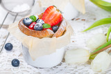 Muffins with cottage cheese and fresh strawberries and blueberries in toasted bread, delicious Breakfast - 195957562