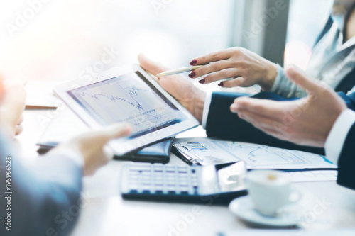 Image of human hand pointing at touchscreen, working environment at meeting