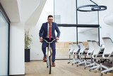 Businessman riding a bicycle - 195967306