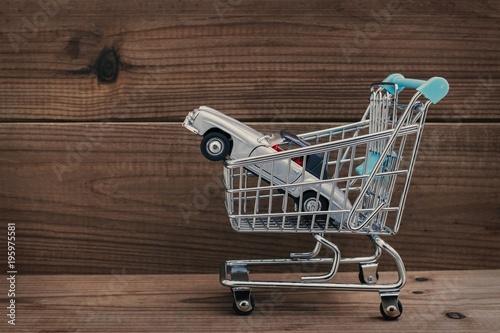 Fototapeta shopping cart with car, concept of buying car