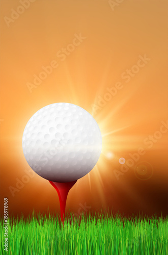 Grass, golf ball on red tee and shiny sunset