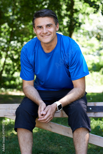 Fotobehang Jogging Portrait Of Mature Man Resting Whilst Exercising In Countryside