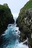 Huge rocks, ocean and cliffs in Faroe Islands