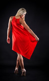 beautiful girl in red dress in studio