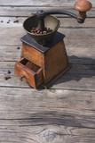 Vintage coffee grinder on wooden table - 196006324