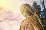 Virgin Mary statue. Vintage sculpture of sad woman (Religion, faith, suffering, love concept) - 196009583