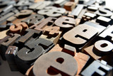 Photo of wooden letterpress closeup, various typefaces