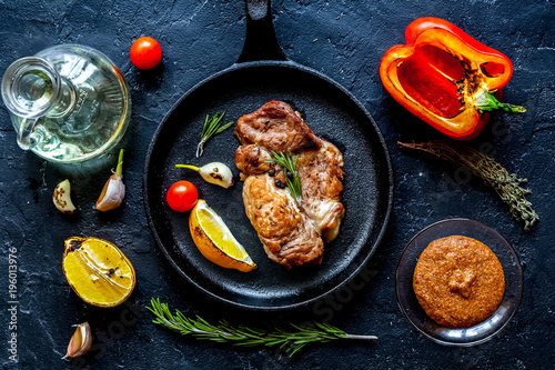 concept cooked steak on dark background top view