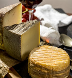 Tasting of oldest french AOC soft pudgent yellow cheese Livarot and semifirm Tomme french cheeses - 196018932