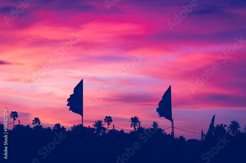 Aluminium Candy roze Sunset with flags silhouette, Koh Phangan, Thailand