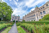 Historic parliament building in the citycenter of Victoria with colorful flowers on a sunny day - Vancouver Island, Canada - 196027516
