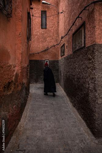 Old men walking in narow street in Morocco