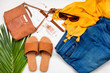 Summer street urban style. Fashion summer girl clothes set, accessories. Trendy sunglasses, slippers, handbag clutch,  watch, jeans, scarf. Summer lady. Creative urban overhead summer top view