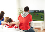 football fans watching soccer game on tv at home - 196044361