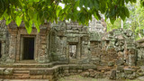 Sacred Angkor Wat stone temple with stunning carved details and lush greenery