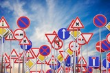 Many road signs against blue sky. 3D rendered illustration. - 196060711