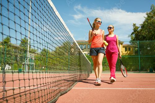 Aluminium Tennis Two female tennis players on a tennis court