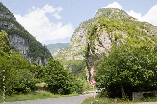 Foto op Aluminium Herfst Scenic route to lake Ritsa in Abkhazia. The beautiful Caucasus mountains in the summer