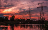 high-voltage  power lines at sunset. - 196091182