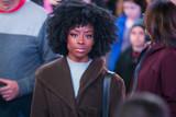 Pretty African American woman on a crowded city sidewalk - 196092922