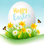 Easter Holiday Background. Colofrul eggs in green grass and flowers. Vector.. - 196100997