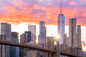 Beautiful sunset over brooklyn bridge in New York City