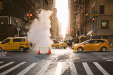 Manhattan morning sunrise view with yellow cabs - 196103701