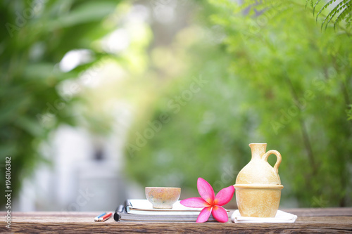 Plexiglas Plumeria Vintage yellow pot and old cup and notebooks