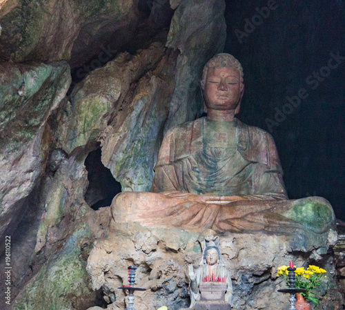 Plexiglas Boeddha marble stone Buddha shrine in the caves of Marble Mountain, Danang, Vietnam