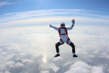 Skydiver is flying in the winter sky.