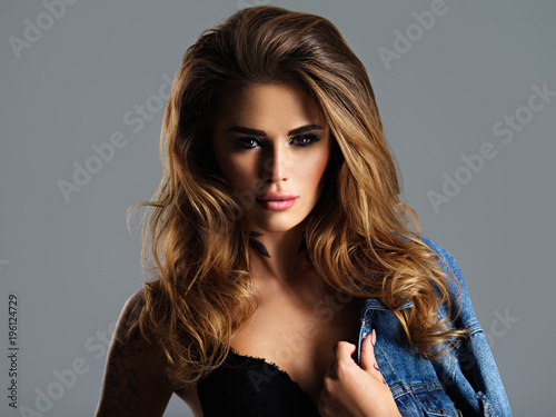 Foto op Canvas Kapsalon Portrait of young adult sexy woman with brown hair.