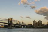 Brooklyn bridge at sunset/Hudson river with the Brooklyn bridge and Brooklyn buildings on a late summer sunset. - 196142159