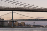 Suspension bridges in perspective/Lower Manhattan New York bridges seen as one below the other at sunset.