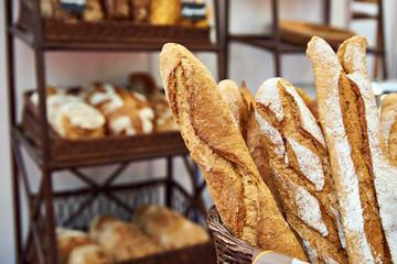 Bread baguettes in basket at baking shop