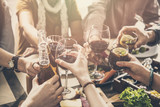 Group of people having meal togetherness dining toasting glasses - 196150338