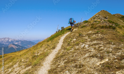 Tourist on the mountain trail, Beautiful summer landscape on background