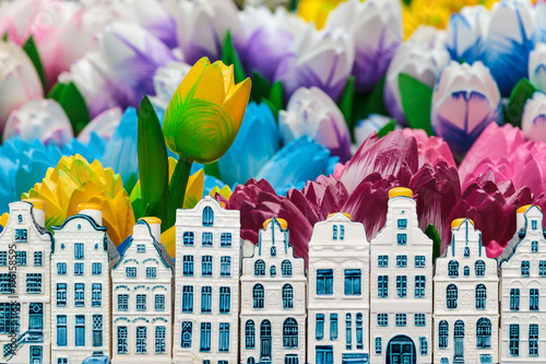 Wooden tulips with small souvenir Amsterdam canal houses