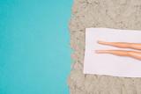 girl sunbathing on the beach near the sea - 196159388