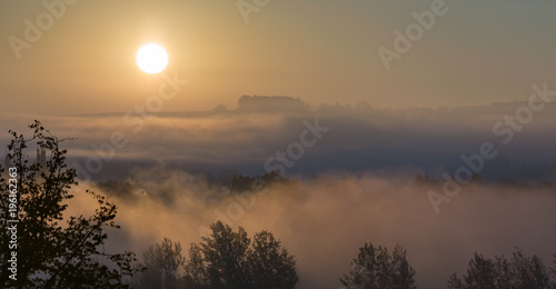 Fotobehang Zonsopgang Cloudscape panorama of sunrise over forest