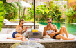Couple busy with tech gadgets while on vacation