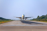 Plane taking off in the small airport on Skiathos island, Greece